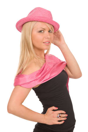 portrait of blond woman in pink hat on a white background photo