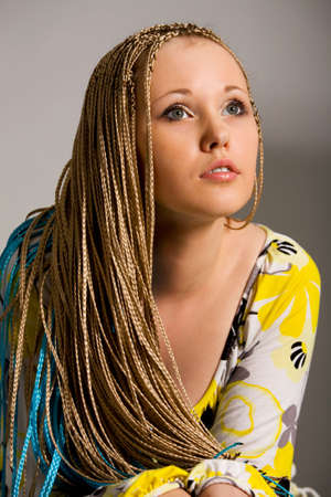 blond woman with the braids on a white background Stock Photo - 3573609