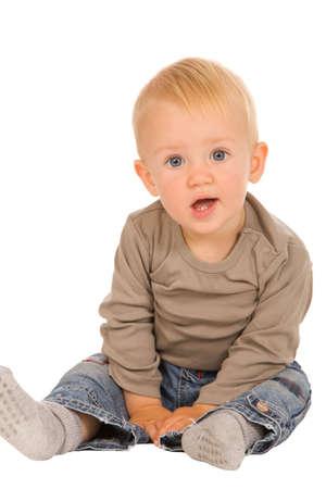 closeup portrait of emotional boy on a white background photo