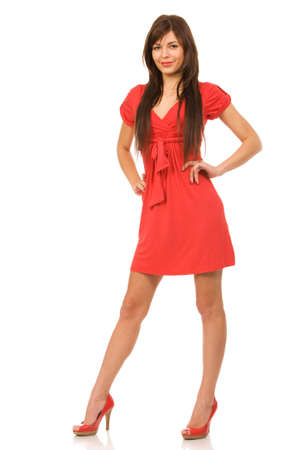 white women: pretty woman in red dress on a white background Stock Photo