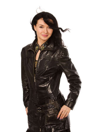 young woman in leather coat on a white background