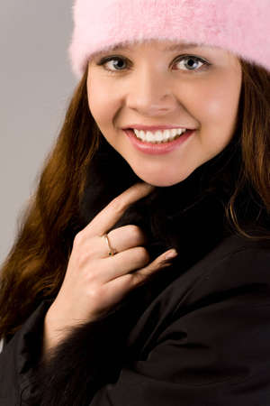closeup portrait of young woman in pink cap photo