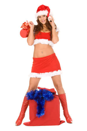 pretty woman dressed as Santa Claus with sack of presents Stock Photo
