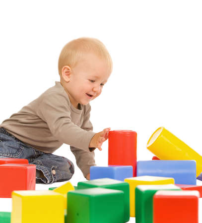 little boy play with bricks. isolated on a white background photo