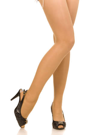 female legs in high heel shoes isolated on a white Stock Photo
