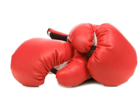 two red boxing gloves on a white background close-up