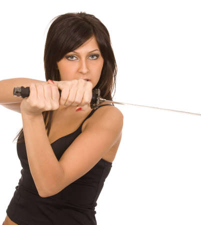 imminence: mujer morena con espada sobre fondo blanco Foto de archivo