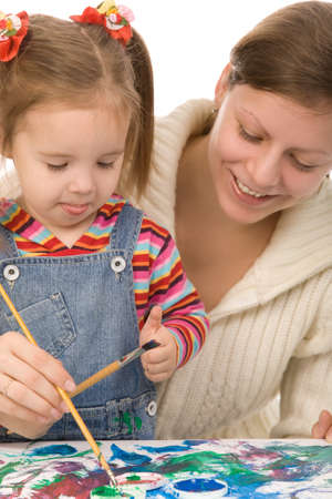 Mother and the daughter draw photo