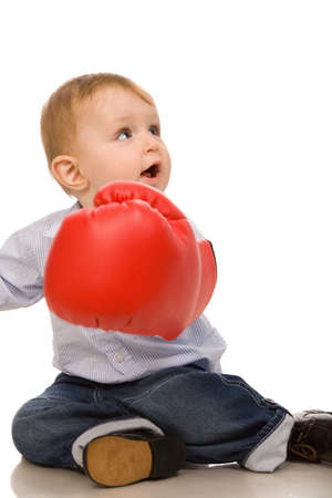 little boy with boxing glove on a white background photo