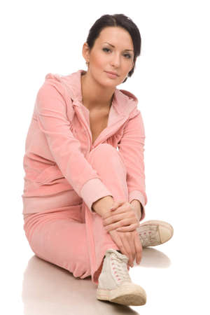 young woman makes exercises on a white background Stock Photo - 4191106