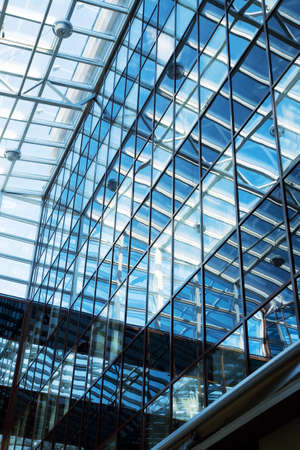 the futuristic business center roof construction from glass and steel Stock Photo