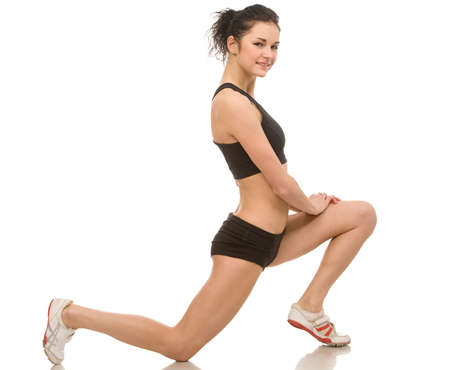 young woman makes exercises on a white background photo