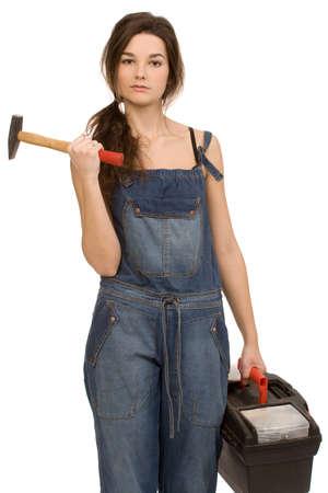 salopette: jeune femme avec des outils sur un fond blanc Banque d'images