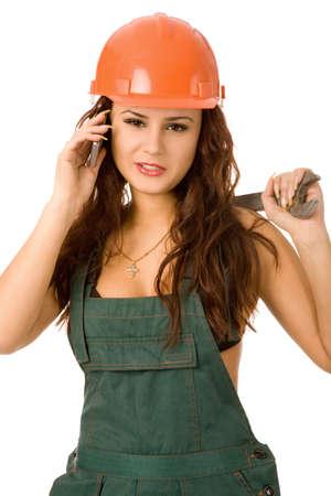 riparatore: pretty woman casco in arancione su sfondo bianco