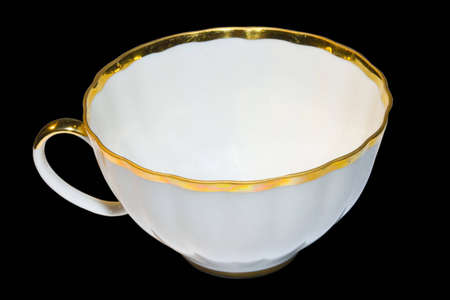 plainness: the white teacup isolated on black Stock Photo