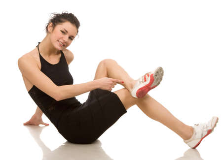 young woman makes exercises on a white background Stock Photo
