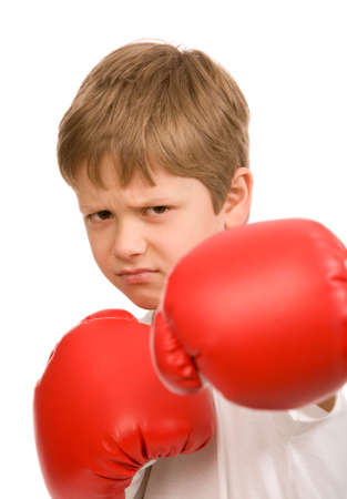 teen boy with red boxing gloves on a white background photo