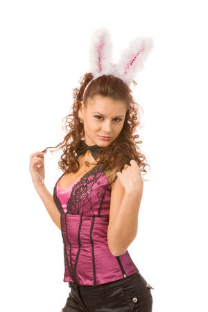the seducer: portrait of young woman dressed as sexy rabbit Stock Photo
