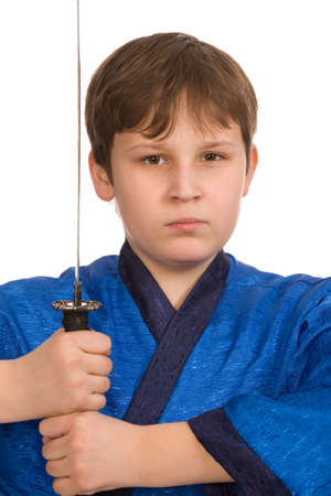imminence: muchacho adolescente en kimono azul con espada Foto de archivo