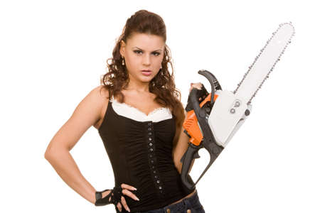 young woman with motor saw on a white background photo
