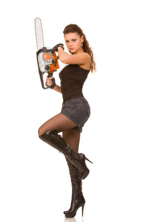 young woman with chainsaw on a white background photo