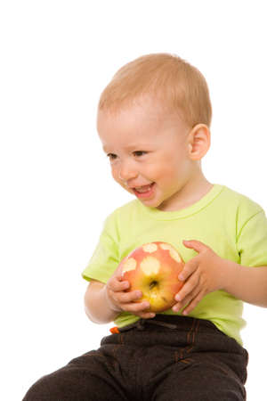giggle: small boy with apple on a white background Stock Photo