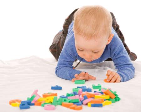 small boy study the alphabet on a white background photo