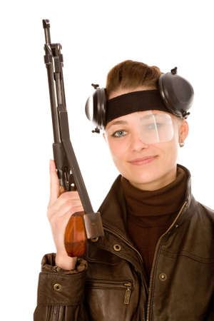 young woman with sports gun on a white background photo
