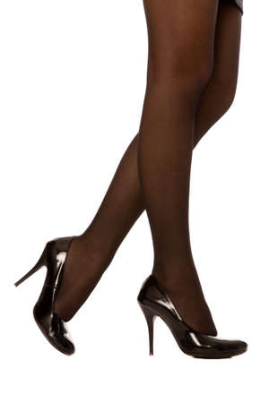 high heel shoes: female legs in high heel shoes isolated on a white background