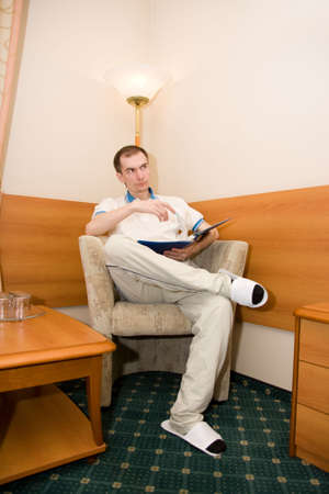 portrait of the man sitting in a chair photo