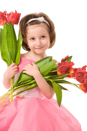 a closeup photo of the young girl in pink dress with the bunch of artificial tulips Stock Photo