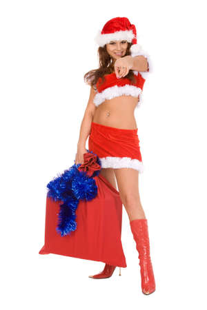 portrait of a young brunette woman in christmas costume pointing to yuo on a white background photo