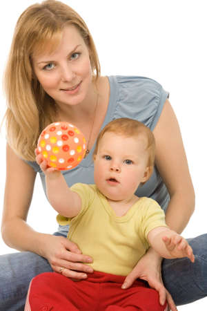 closeup portrait of the mother with young daughter playing with a ball isolated on a white background photo
