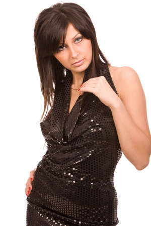 closeup portrait of the young brunette woman in a black dress on a white background photo
