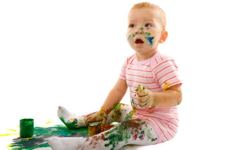 portrait of the little boy covered with bright paint Stock Photo