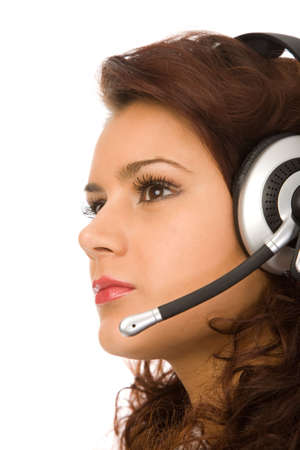 closeup portrat of the beautiful brunette woman with a headset photo