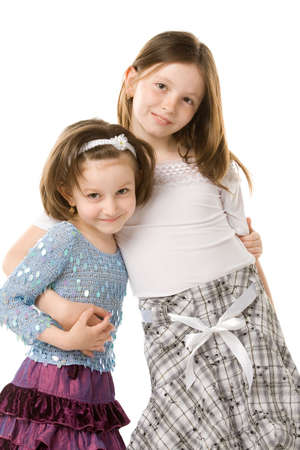 a closeup photo of two smiling girls isolated on a white background photo