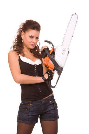 closeup portrait of the young brunette woman in jeans with a hand saw on a white background photo
