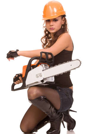 portrait of the young brunette woman in helmet with a hand saw on a white background photo