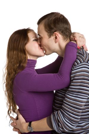 young loving couple kissing on white background photo