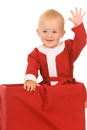 little boy dressed as Santa Claus on a white background Stock Photo - 5513645