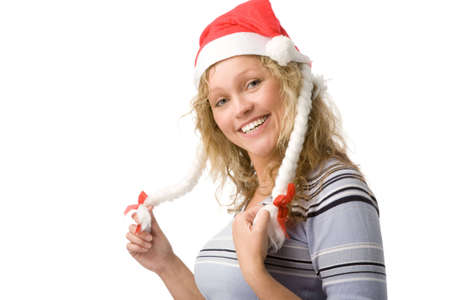 closeup holiday portrait of a young blond woman in christmas hat on white background photo