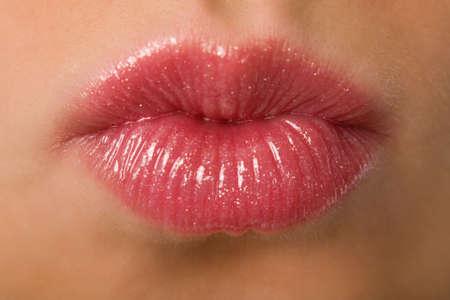 the female lips sending a kiss macro Stock Photo