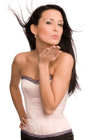 woman in pink corset blowing a kiss isolated on white  Stock Photo