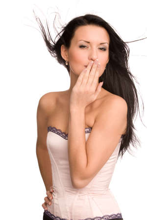 woman in pink corset blowing a kiss isolated on white Stock Photo - 5832113