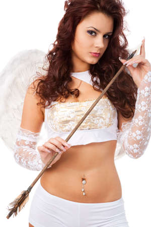 woman dressed as attractive female cupid on white background photo