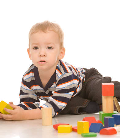little boy play with bricks photo