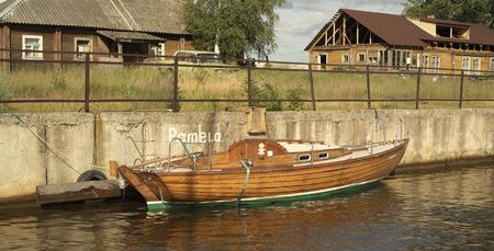 skiff: Sailing yacht folkboat at the berth  Stock Photo