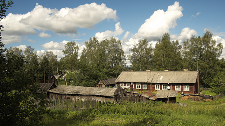 Russian North  Vologda region  Rural house with outbuildings  Typical housing for local residents  photo
