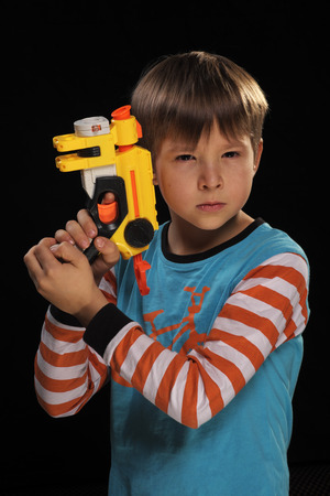 special agent: A boy with a toy gun depicts a special agent  Stock Photo